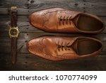 men s brown dress shoes on a... | Shutterstock . vector #1070774099