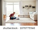father playing ukulele with... | Shutterstock . vector #1070775560