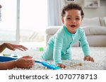 mixed race mum and toddler son... | Shutterstock . vector #1070778713