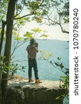 relaxed backpacker traveler... | Shutterstock . vector #1070780240