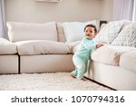 happy mixed race toddler boy... | Shutterstock . vector #1070794316