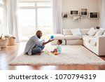 black father and toddler son... | Shutterstock . vector #1070794319