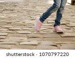 legs of a teenager. walk around ... | Shutterstock . vector #1070797220
