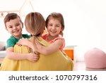 cute little children hugging...   Shutterstock . vector #1070797316
