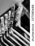 Close-up of Single Typewriter typebar A and at symbol - stock photo