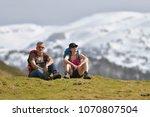 hikers admiring mountain... | Shutterstock . vector #1070807504