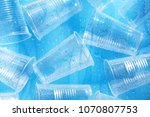 disposable plastic cups on a... | Shutterstock . vector #1070807753