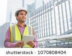 engineer with hardhat is... | Shutterstock . vector #1070808404