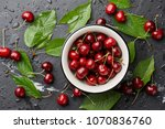 Fresh sweet cherries bowl with...