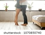 barefoot woman standing on...   Shutterstock . vector #1070850740