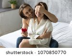 loving man closing womans eyes... | Shutterstock . vector #1070850770