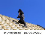 roofer  carpenter on the roof | Shutterstock . vector #1070869280