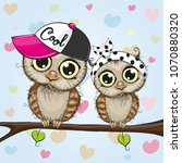 two cartoon cute owls is... | Shutterstock .eps vector #1070880320