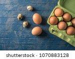brown fresh farm eggs in green...   Shutterstock . vector #1070883128