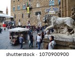 Small photo of Florence, Italy - September 24, 2017: Tourists admire the historical buildings and statues on the Piazza della Signoria in Florence, Italy on September 24, 2017