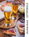 two glasses of light beer with... | Shutterstock . vector #1070938313