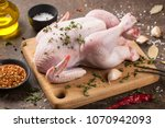 fresh raw chicken on cutting... | Shutterstock . vector #1070942093
