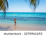 a young woman is vacationing in ... | Shutterstock . vector #1070961653