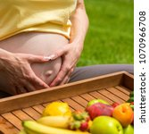 a pregnant woman in a yellow t...   Shutterstock . vector #1070966708