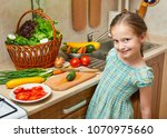 child girl cooking in home...   Shutterstock . vector #1070975660