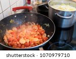 cooking prawns and tomatoes in...   Shutterstock . vector #1070979710