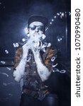 punk hipster man is smoking a... | Shutterstock . vector #1070990480