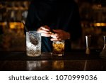 jar of ice and a glass filled... | Shutterstock . vector #1070999036