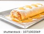 orange pie with orange slices | Shutterstock . vector #1071002069