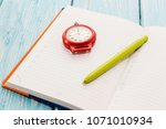 notepad and stopwatch  on... | Shutterstock . vector #1071010934