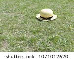 Farmer Amish Boy's Hat On Gras...