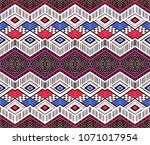 ikat geometric folklore... | Shutterstock .eps vector #1071017954