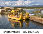 uros floating island  lake... | Shutterstock . vector #1071024629