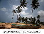an old fishing boat on the... | Shutterstock . vector #1071028250