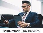 confident entrepreneur in... | Shutterstock . vector #1071029876