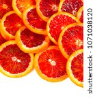 blood orange slices isolated on ... | Shutterstock . vector #1071038120