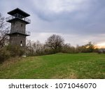 Small photo of The Erben's lookout tower - ERBENOVA VYHLÍDKA, on the top of the hill . On the oval shield is the coat of arms of the city.