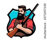 hunter holds shotgun in his...   Shutterstock .eps vector #1071057230