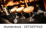 cappuccino martini being made... | Shutterstock . vector #1071057410