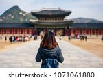 young asian woman traveler with ... | Shutterstock . vector #1071061880