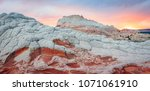 colorful sunset at white pocket ... | Shutterstock . vector #1071061910