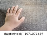the blind kid's hand and...