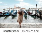 young woman in a hat on a... | Shutterstock . vector #1071074570