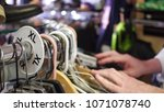 male shopper looking through... | Shutterstock . vector #1071078740
