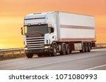 truck goes on highway in... | Shutterstock . vector #1071080993