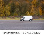 commercial compact cargo mini... | Shutterstock . vector #1071104339