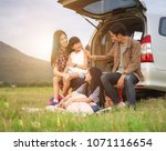 happy family asia enjoying and... | Shutterstock . vector #1071116654