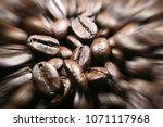 coffee beans close up with zoom ... | Shutterstock . vector #1071117968