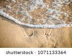 sand dunes  footprints on the... | Shutterstock . vector #1071133364