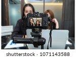 professional digital mirrorless ... | Shutterstock . vector #1071143588