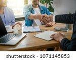 closeup hand shake between sale ... | Shutterstock . vector #1071145853